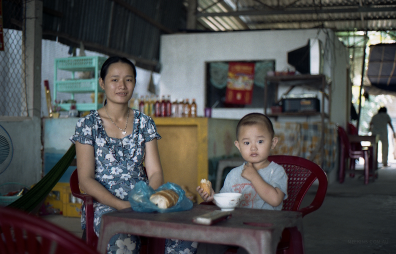 A family on the Mekong River, Vietnam.