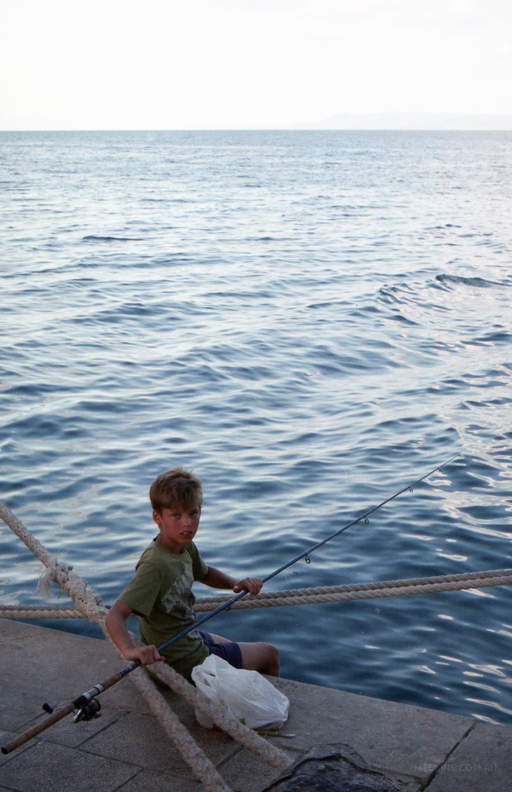 A young fisherman in Croatia.