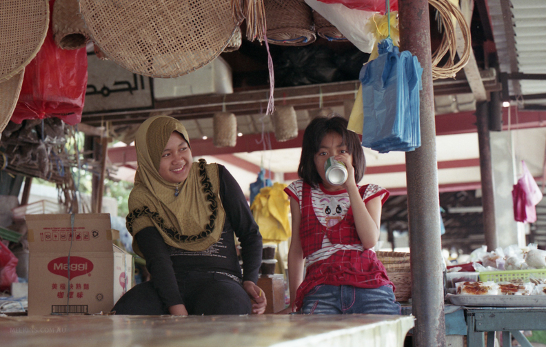Girls at a water market in Brunei