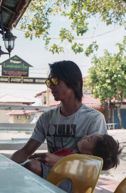 Father and son in Langkawi, Malaysia.
