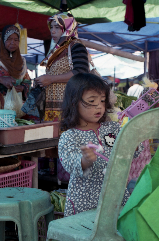 Keeping busy at a water market in Brunei.